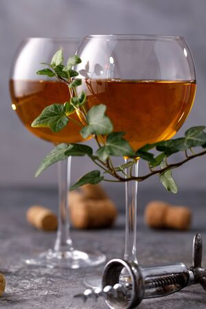 Two glasses with white wine on a textural background. Copy space. Place for your text. Close-up. Stok Fotoğraf