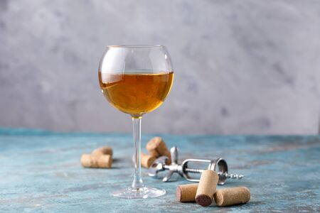 White wine in a glass. The concept of winemaking. Place under your text. Still life on a textural background. Close-up. Banco de Imagens - 129268696