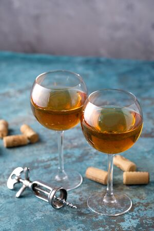 Two glasses with white wine on a textural background. Copy space. Place for your text. Close-up. Banco de Imagens