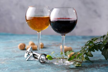 Glasses of white and red wine. The concept of winemaking. Place under your text. Still life on a textural background. Close-up. Banco de Imagens - 129273792
