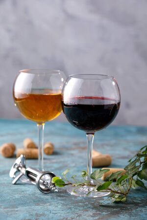 Glasses of white and red wine. The concept of winemaking. Place under your text. Still life on a textural background. Close-up. Banco de Imagens - 129273795