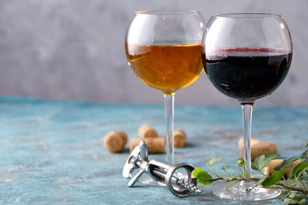 Glasses of white and red wine. The concept of winemaking. Place under your text. Still life on a textural background. Close-up. Banco de Imagens - 129273796