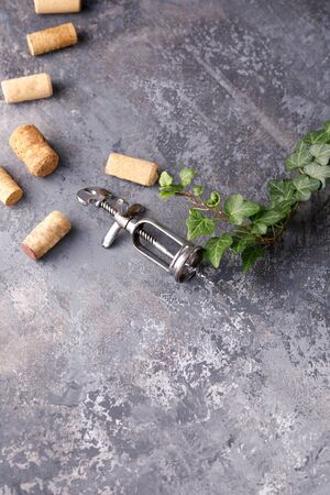 Exquisite vintage corkscrew for wine on a textural background. Copy space. Place for your text. Close-up. 스톡 콘텐츠