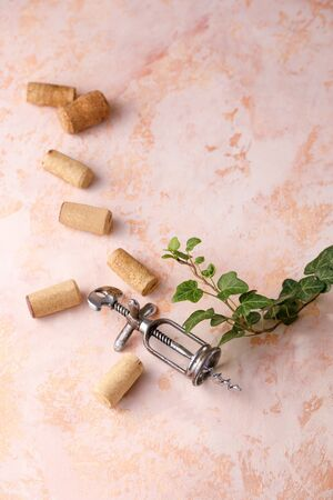 Exquisite vintage corkscrew for wine on a textural background. Copy space. Place for your text. Close-up. 版權商用圖片