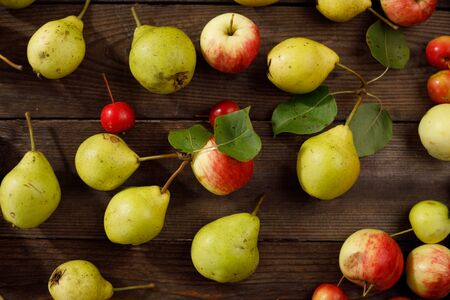 Background from ripe juicy pears and apples for your design. Harvest.