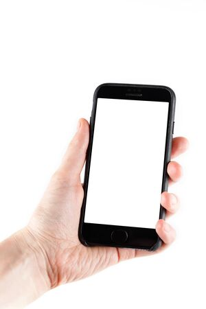 Touch screen smartphone in a hand.Man holding smartphone with blank screen on white background, closeup of hand. Space for text.