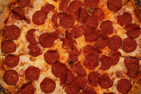 Piperoni pizza texture. Macro. Background of pizza toppings.