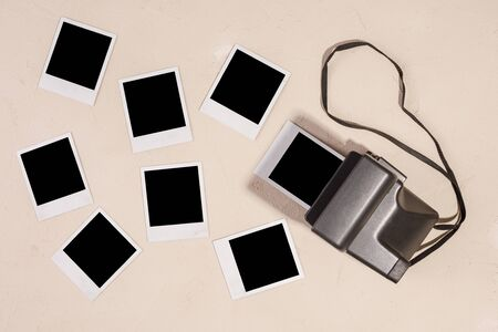 Empty photos and camera on a textural background. The concept of preserving memories. Copy space.