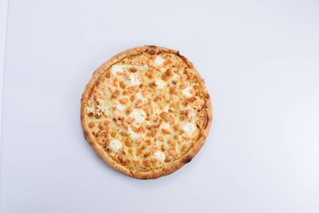 Pizza with salmon and cheese isolated on a white background. Close-up.