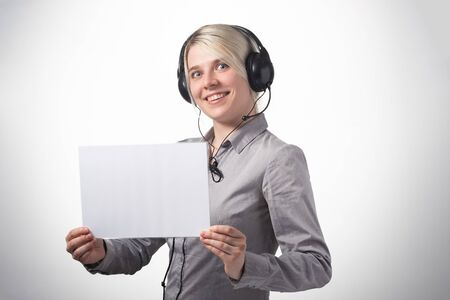 Woman working at call center calling with smile isolated over white background with large area for your text. Copy space.