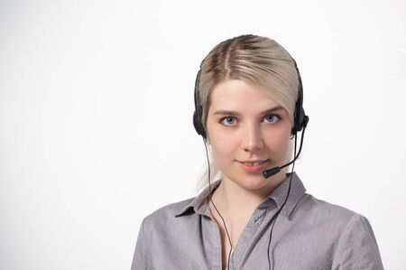 Portrait of attractive business woman with headset isolated over white background with large area for your text. Copy space.