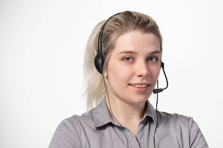 Woman working at call center calling with smile isolated over white background with large area for your text. Cloce-up.