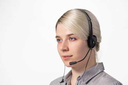 Portrait of an employee call center on white background. Support operator. Close-up. Foto de archivo