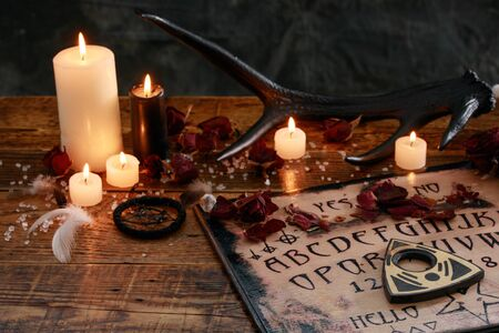 Mystic ritual and candles. Devil's board concept, black magic or fortune telling rite with occult and esoteric symbols. Occultism.