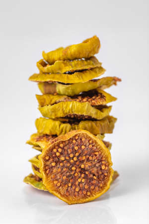 slices of dried figs on a white background. dried fruits. eco. macro. delicacy.