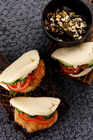 Steamed wheat bun dressed with designer sauce. Vietnamese cuisine concept. Still life.