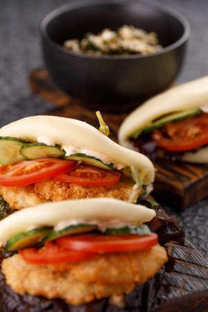 Steamed wheat bun dressed with designer sauce. Vietnamese cuisine concept. Still life.