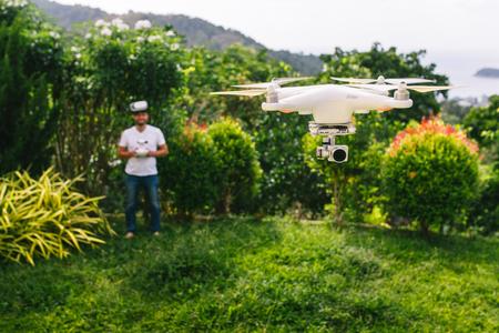 have fun: Man controls a quadrocopter. Stock Photo