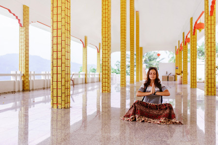 Girl in a Buddhist temple Stock Photo