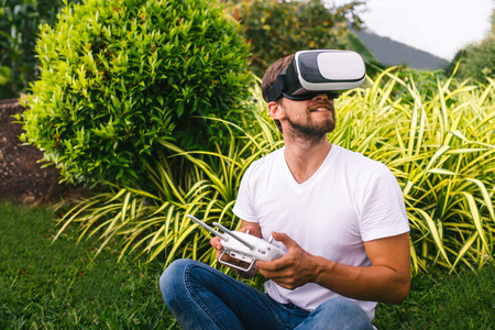 A man in a virtual reality helmet Stock Photo