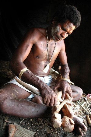 sculptor: Wood sculptor from Asmat Tribe, Papua, Indonesia Editorial