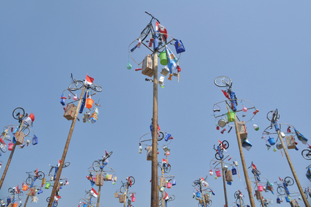 Jakarta, Indonesia - August 17, 2014: Greased pole called a panjat pinang for competition to celebrate of Indonesian Independence Day on August 17, 2014 in Jakarta, Indonesia. Cities and villages across Indonesia celebrated the countrys 70th anniversary