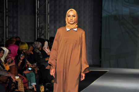 25 29: A model wears creations by Indonesian Fashion Chamber during the Muslim Fashion Festival in Jakarta on May 25, 2016. Muslim Fashion Festival is held in Jakarta on May 25 - 29, ahead of the month of Ramadan that starts in Indonesia on June 6
