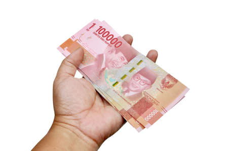 Holding hundred thousand rupiah