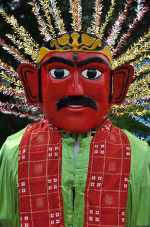 Ondel-ondel are the giant puppets that are inseparable from Betawi culture, Jakarta, Indonesia. These are made on bamboo frames to allow persons to carry them around from inside. These are usually in pairs, male and female Ondel-ondel.