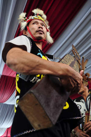 Dayak people are playing Sape the  traditional guitar from Dayak Borneo, Kalimantan, Indonesia. Éditoriale