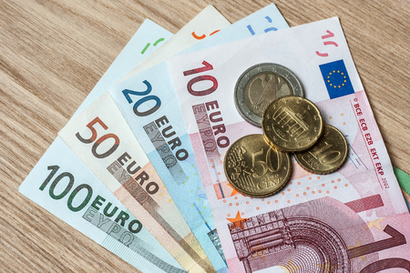 euro banknotes: euro banknotes coin wood table Stock Photo