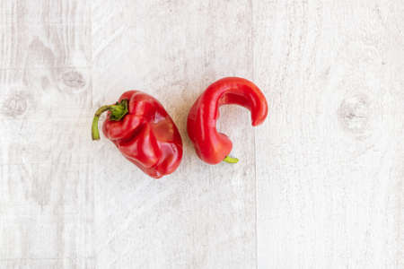 Trendy ugly organic peppers on the table. Ugly food concept, Ugly shaped organic vegetables.