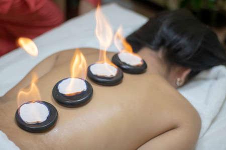 Back massage with hot zen basalt stones.