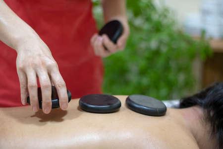 Spa Hot Stone Massage, asian woman relaxing