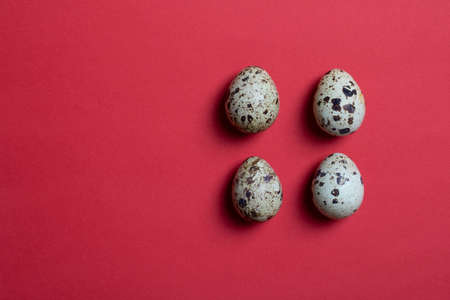 background with four small quail eggs. Eco products. Horizontal format, top view and copy space food