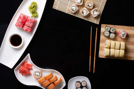 Variation of sushi and rolls on stone table. Sashimi set. Flat lay with copy space.