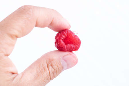 Man holding Unusual weird shape ripe red strawberry, non commercialized agricultural product shape, Wasted ugly fruit, imperfect produce Standard-Bild