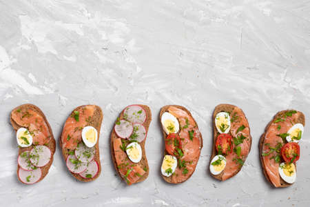 Sandwiches with salmon, cured bresaola, crispy bread, tomatoes, boiled quail eggs, radish Japanese meal
