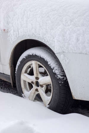 Old car under white snow