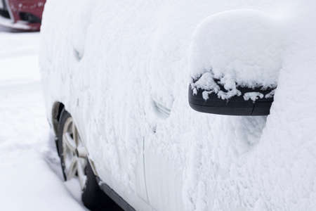 car covered with snow in winter day, horizontal 写真素材