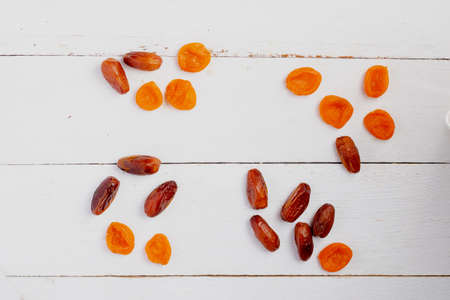 Mixed dried fruits in heats, wooden background. Flat lay Reklamní fotografie