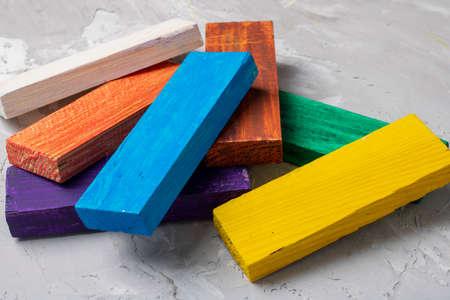Blue, yellow, red, orange, white and purple wood cubes blocks children development