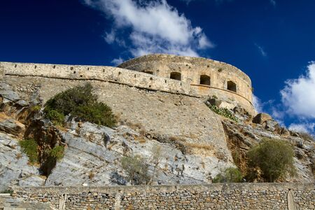 loopholes: The tower with loopholes on the island-fortress of Spinalonga. Greece, Crete