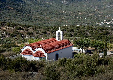 little white church with a red roof. Dikti Mountains. Crete. Greece