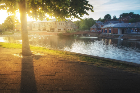 pavers: Sunset on the river Exe embankment.  Exeter. England