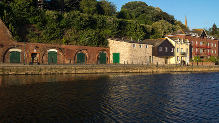 devonian: cellars and houses on Exeter Quay. Exe river. Devon. UK