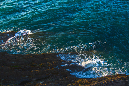 Coast in north Devon. Near the town of Ilfracombe. Evening. The waves beat against the shore rocks. View from above. UK