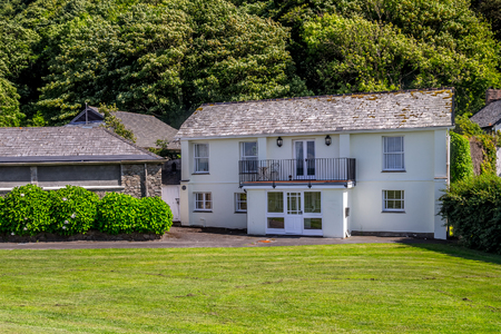 lynmouth: Lynmouth, Devon, England, 13 July 2016: North Devon coast. Two-storey white house on the north coast of Devon. The village of Lynmouth. UK