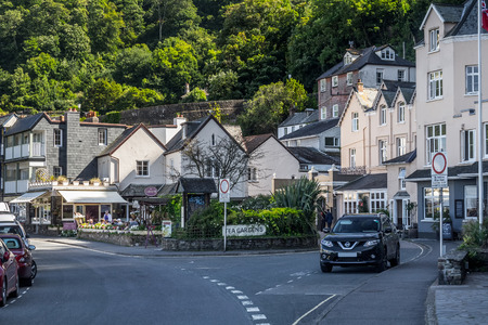 lynmouth: Lynmouth, Devon, England, 13 July 2016: View of the street in the Riverside Road and Lynmouth street. Parked car. Against the backdrop of hills covered by forests. North Devon Coast. Editorial