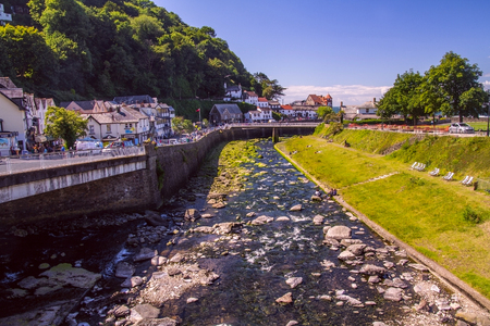 Lynmouth, Devon, England, 13 July 2016: West Lyn River merges with the East Lyn River and is committed to the sea. Houses and Bridge on the left bank. Editorial
